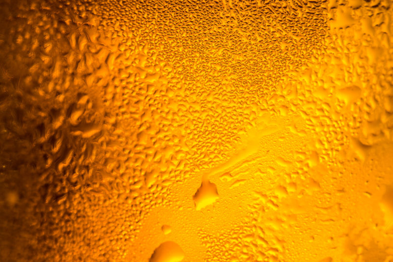 Cold Beer in a Glass with Water Drops on It