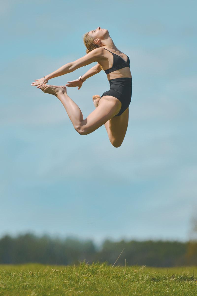 Girl Dancer Jumping in the Field in Joy