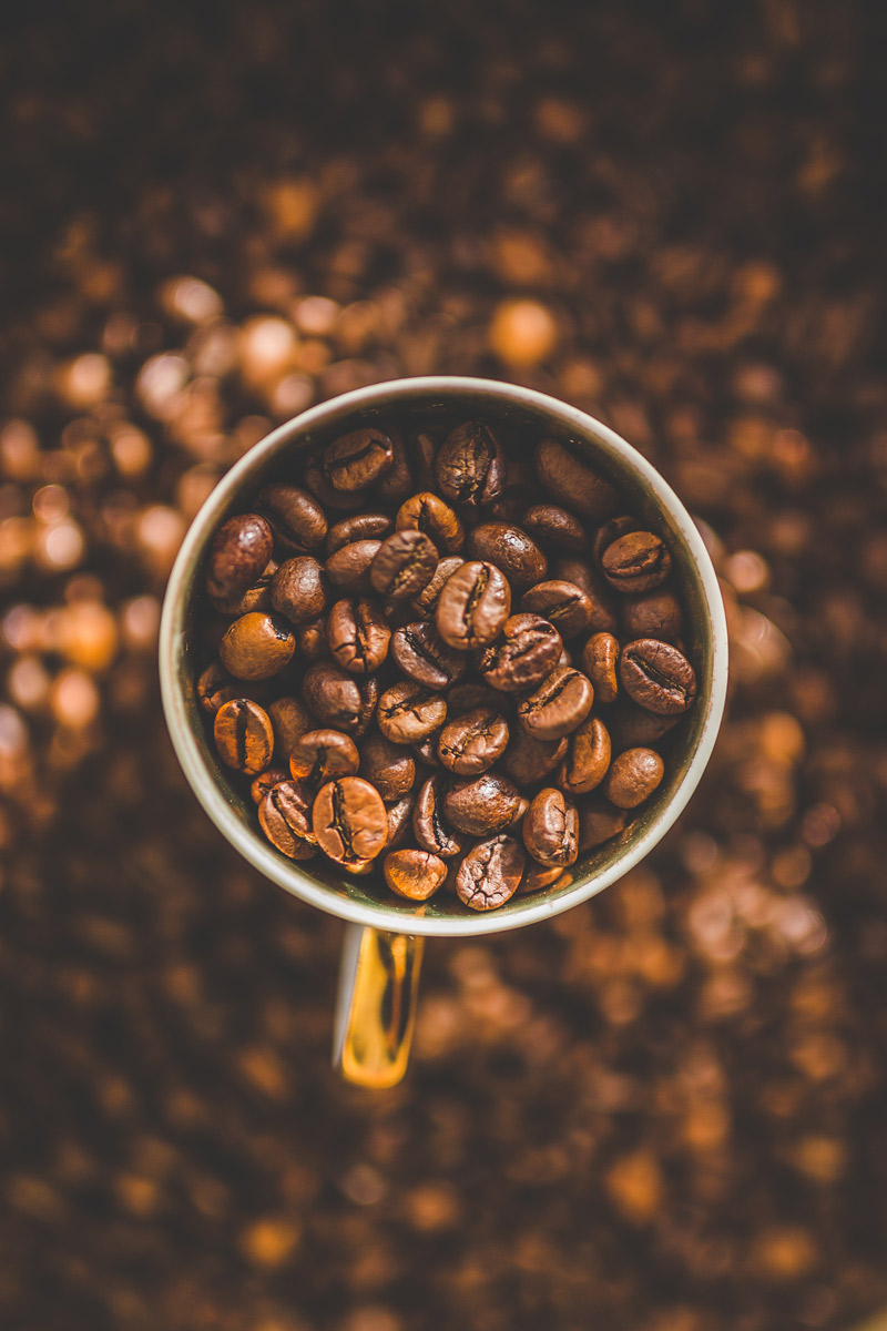 Coffee Beans in a Mug and Background