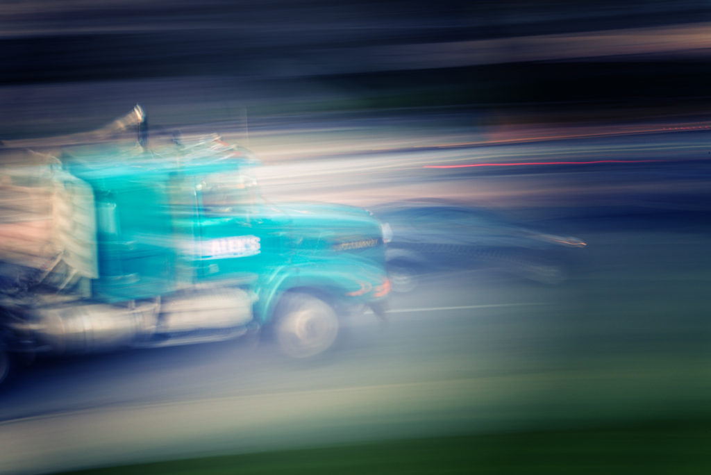 Car and a truck shot using panning technique to show the strength and power of these beautiful machines.