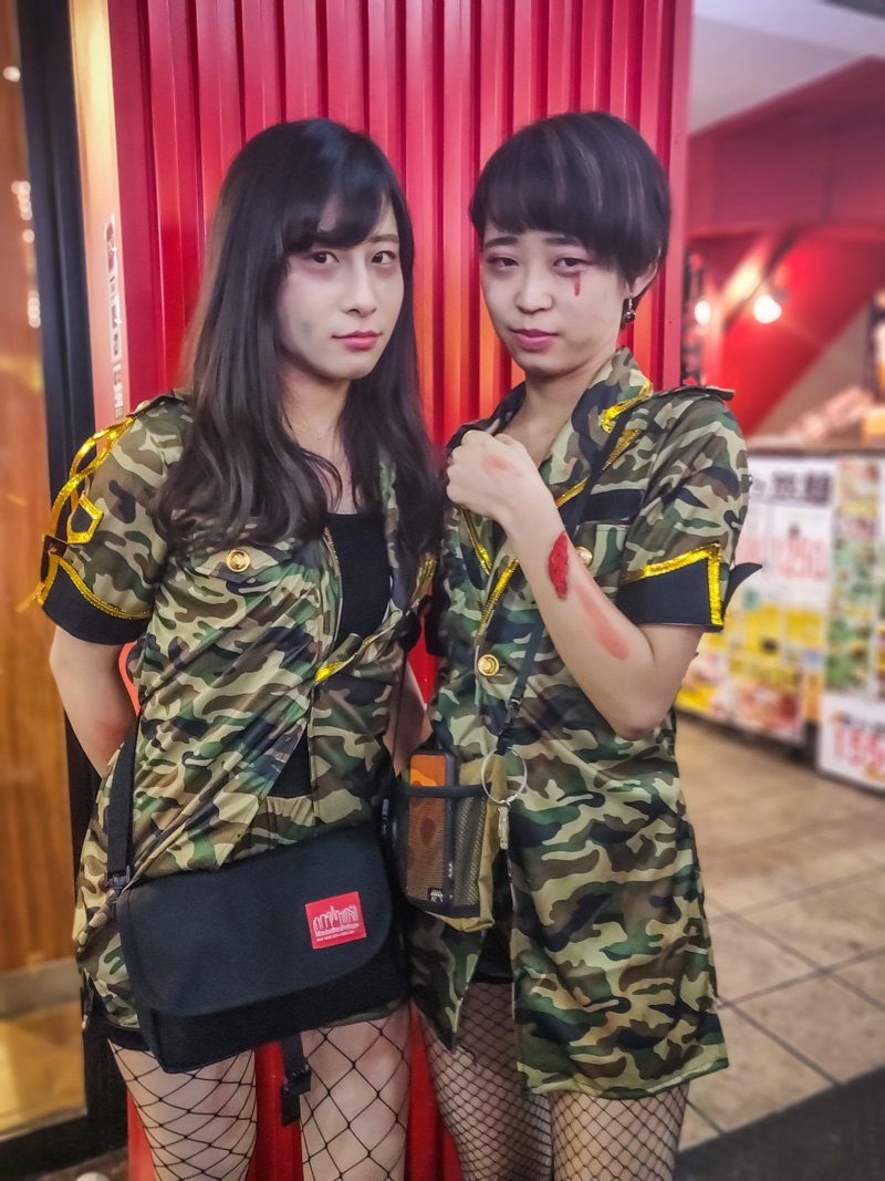 2 Girls dressed up as Army Soldiers for Halloween.