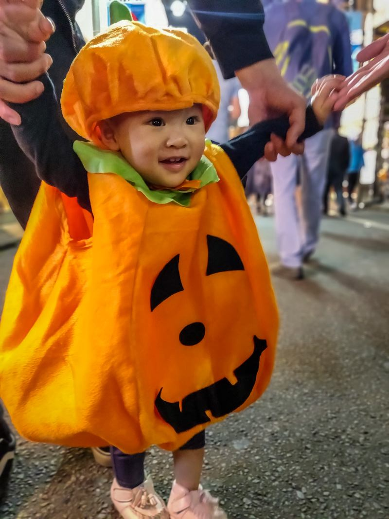 Baby dressed up as a Pumpkin for Halloween.