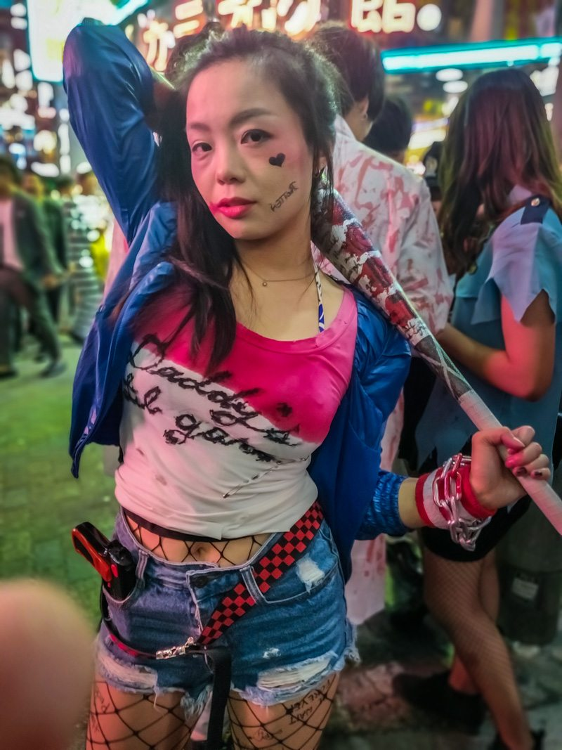 Bad girl with a baseball bat during Halloween.
