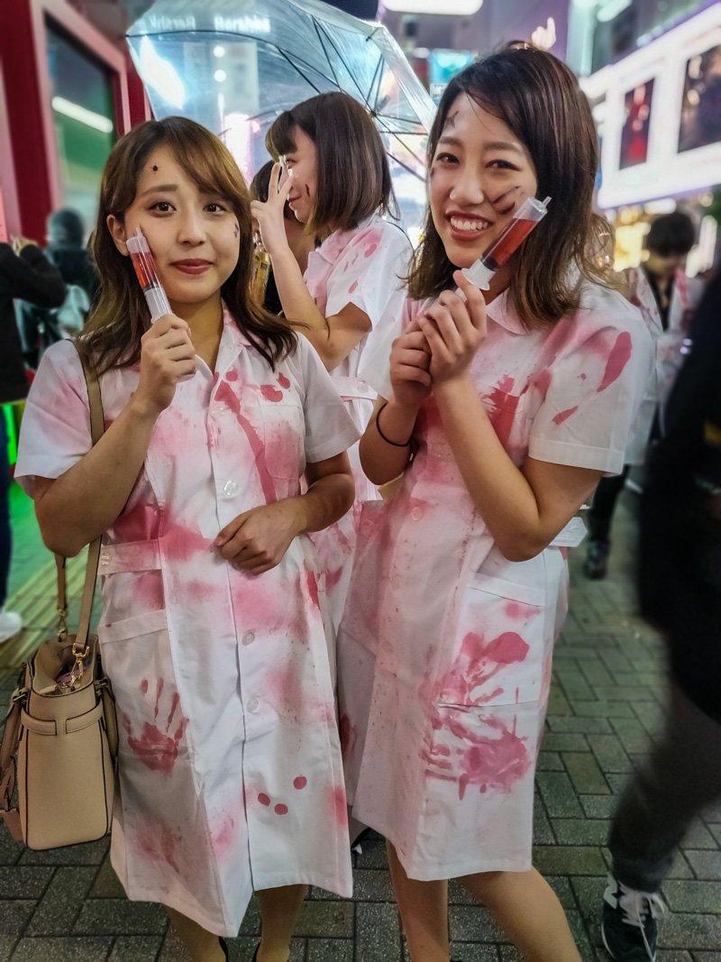 Bloody nurses costumes for Halloween.