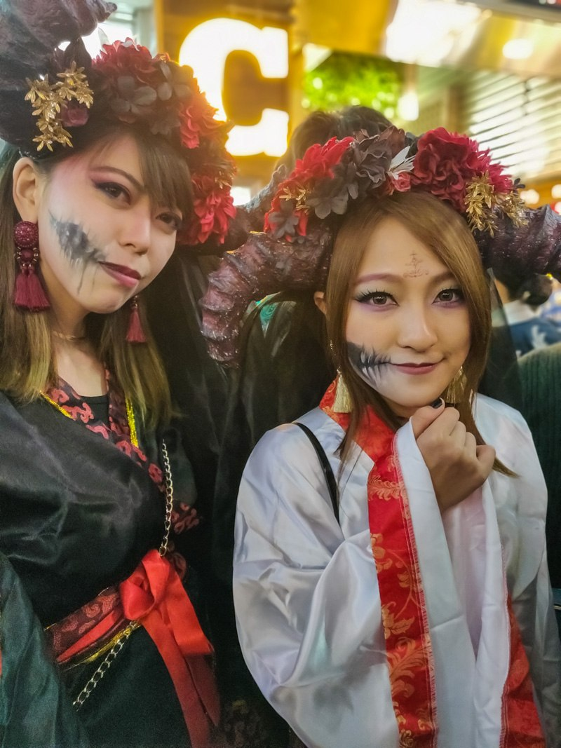Two ladies in Pirate & Zombie Halloween outfits.