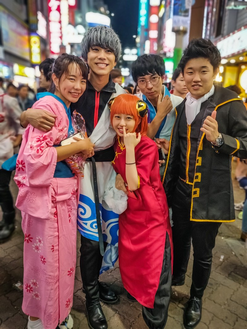 Group of friends in Japanese anime Halloween costumes.