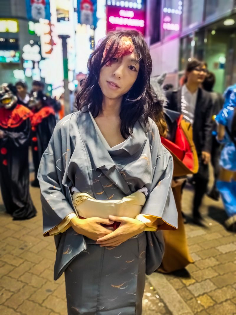 Woman wearing Kimono with her brain out, Halloween Costume.