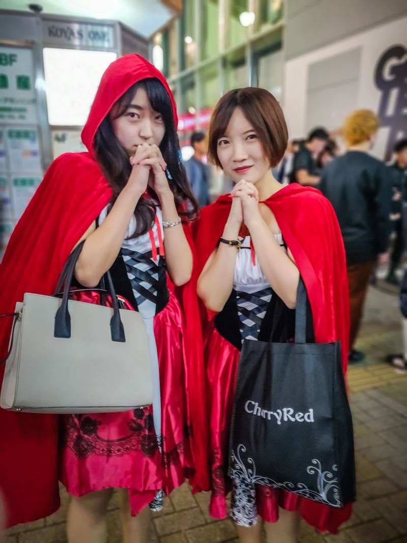 Two girls wearing Little Red Riding Hood Costumes.