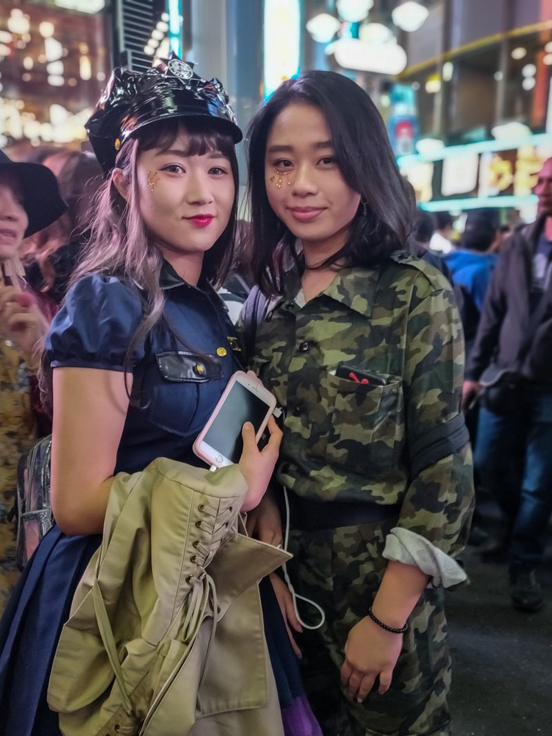 Two ladies dressed up as police and army for Halloween.