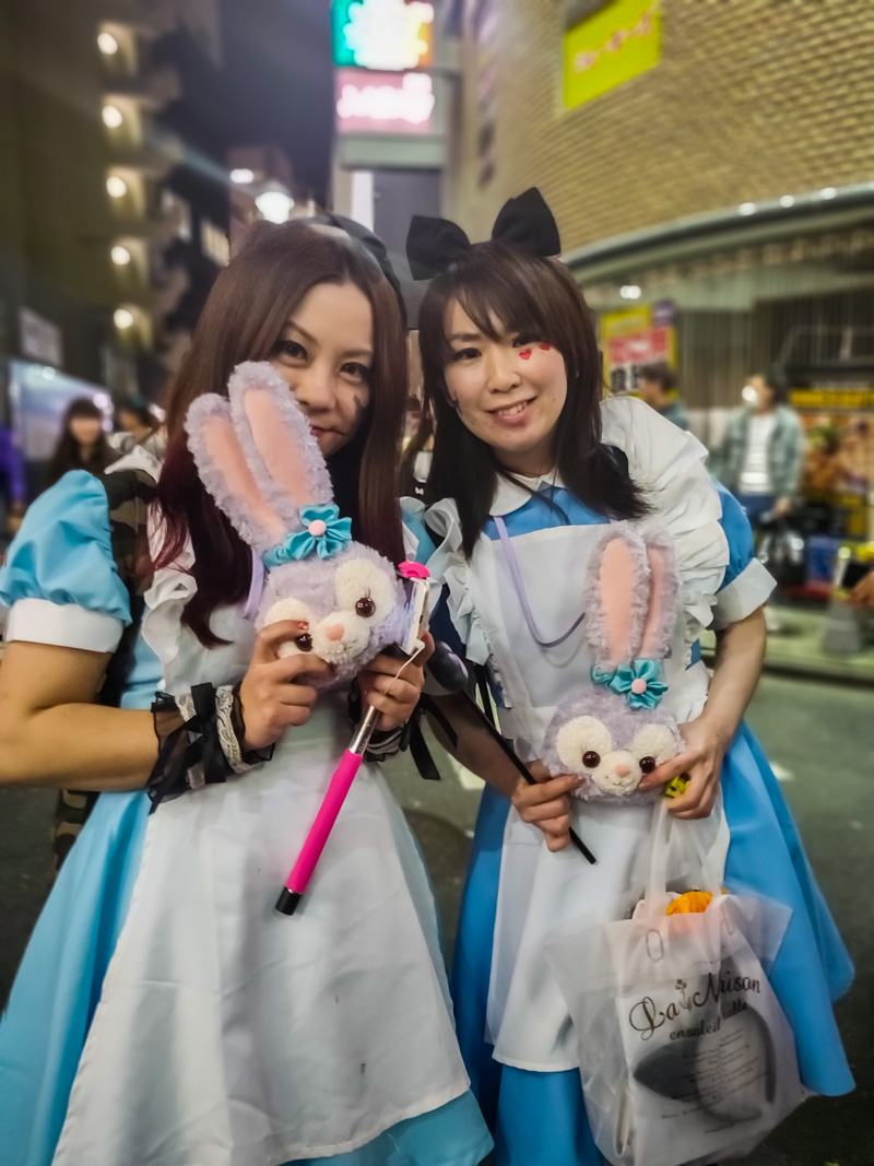 Two ladies with rabbits and blue dresses on Halloween.
