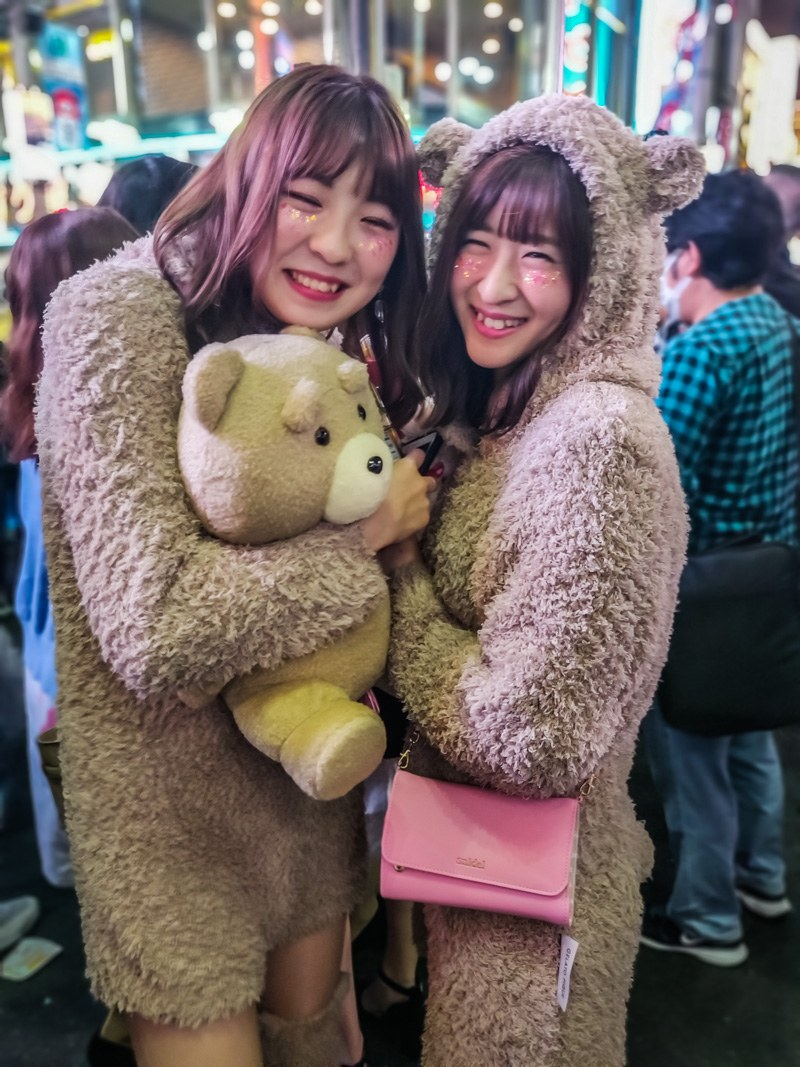 Cute girls dressed as teddy bears for Halloween.