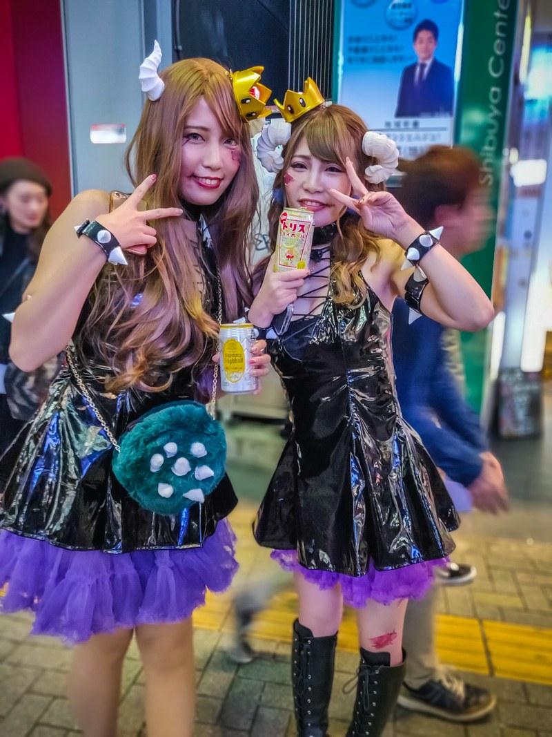 2 Women in Black & Purple Dresses for Halloween