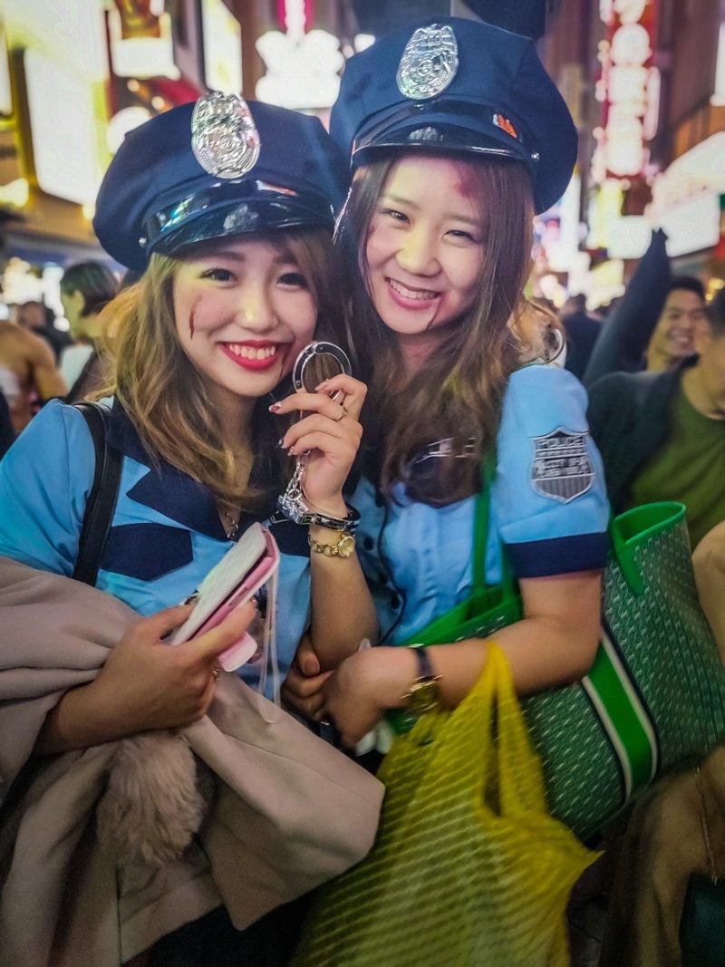 2 Beautiful Ladies in Police costumes.