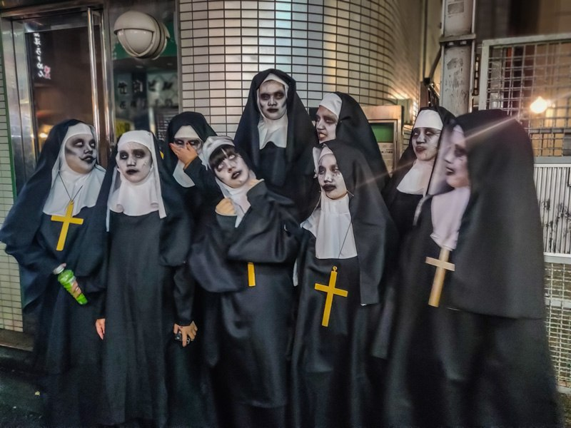 Women dressed up as Female Priests for Halloween.