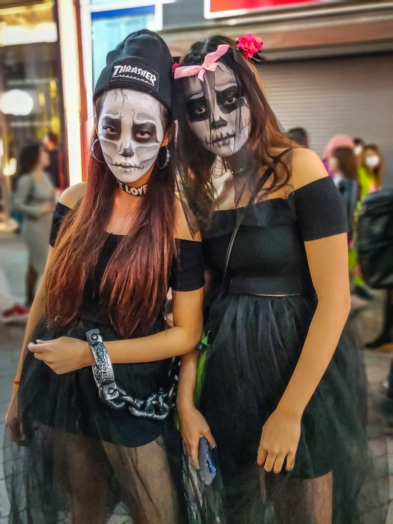 2 zombie women with very interesting white makeup.