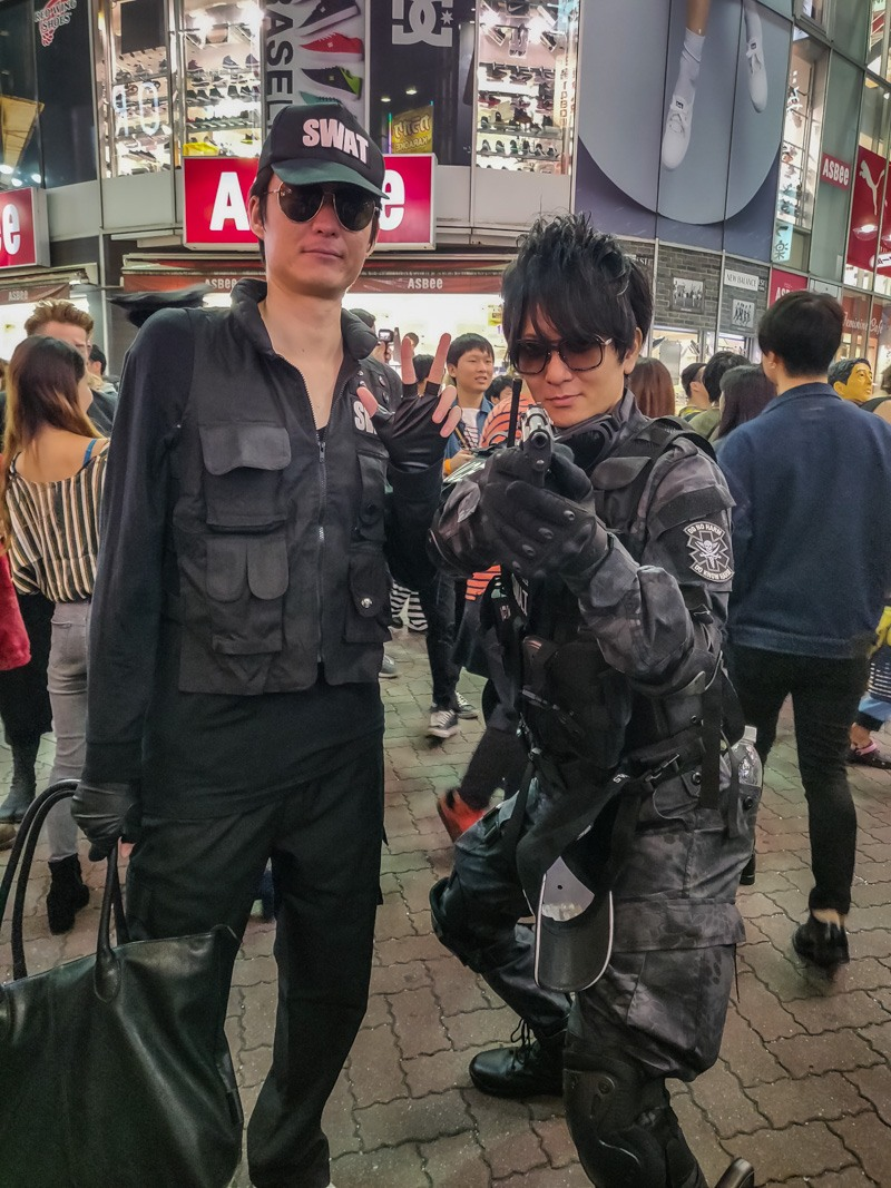 Two men dressed up as Swat Team in Halloween.