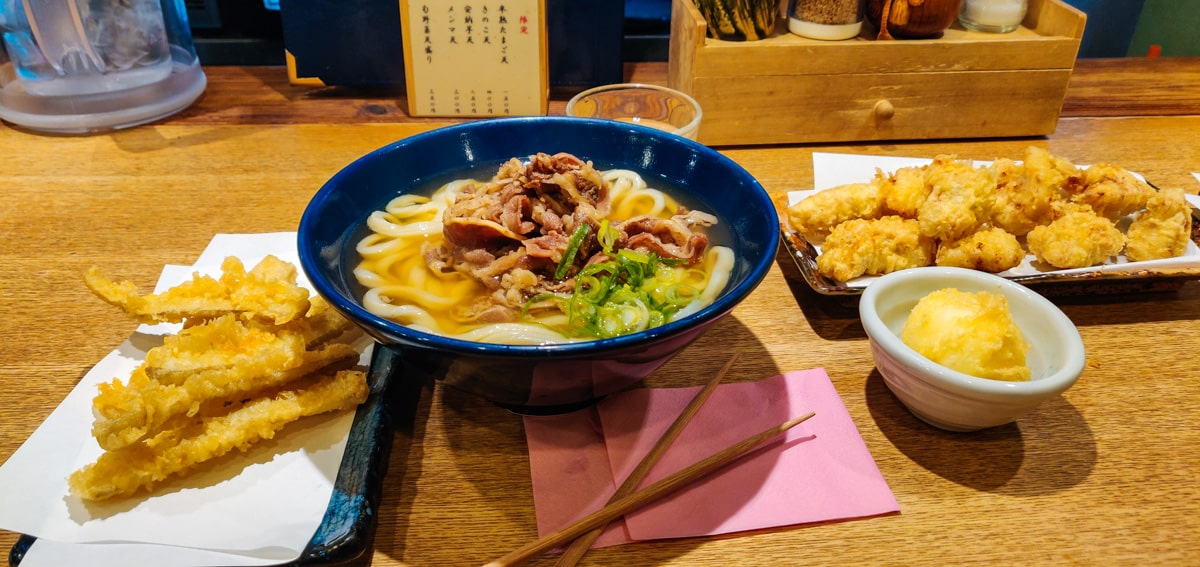 Udon Shin Noodles Soup, with Chicken, Egg and Veggie Tempura on the side.