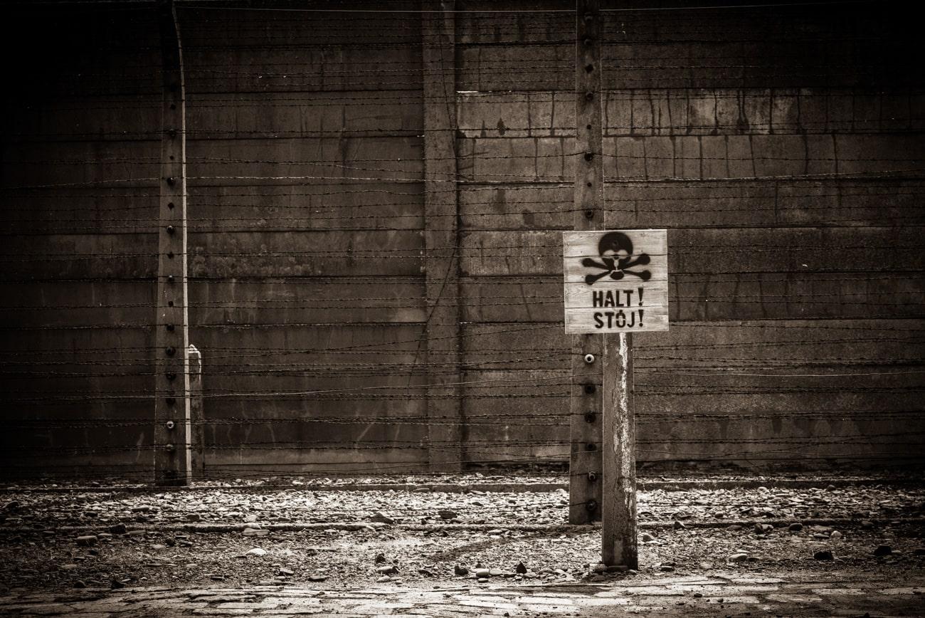 Halt! Stój! Warning sign in sepia tones.