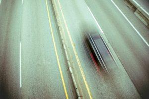 Car Speeding on a Highway, Long Exposure