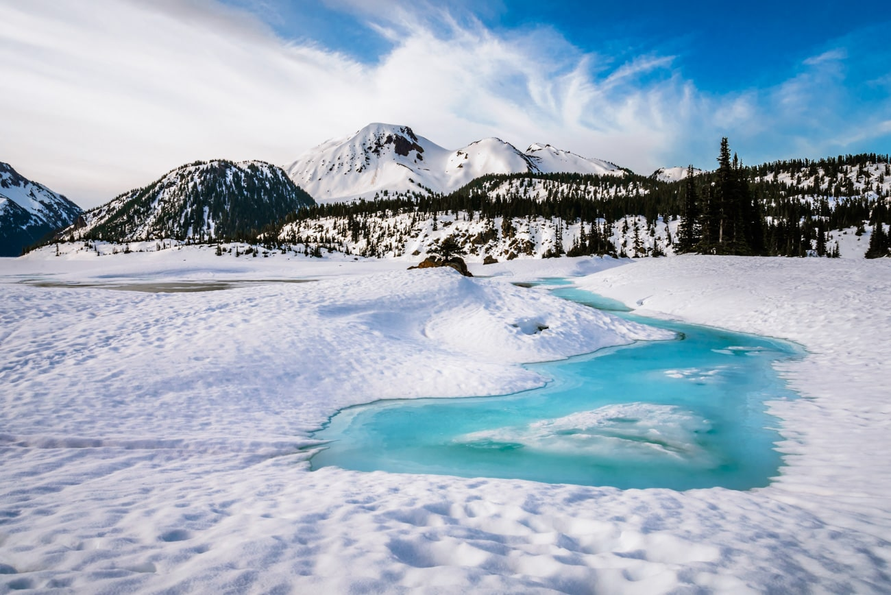 Snow, mountains and white clouds, landscape in Garibaldi Lake, British Columbia, Canad