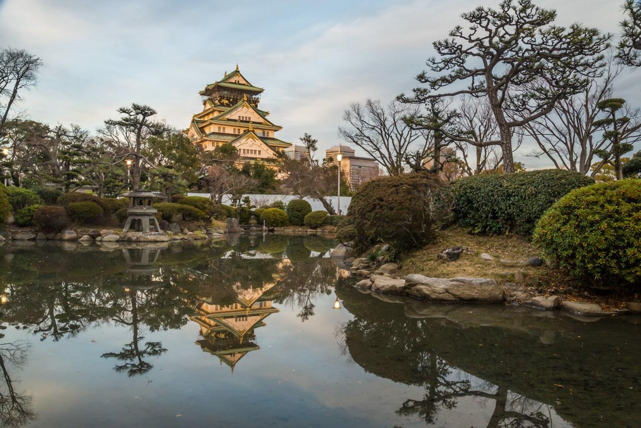 Beautiful Osaka Castle from Japanese Garden at Sunset