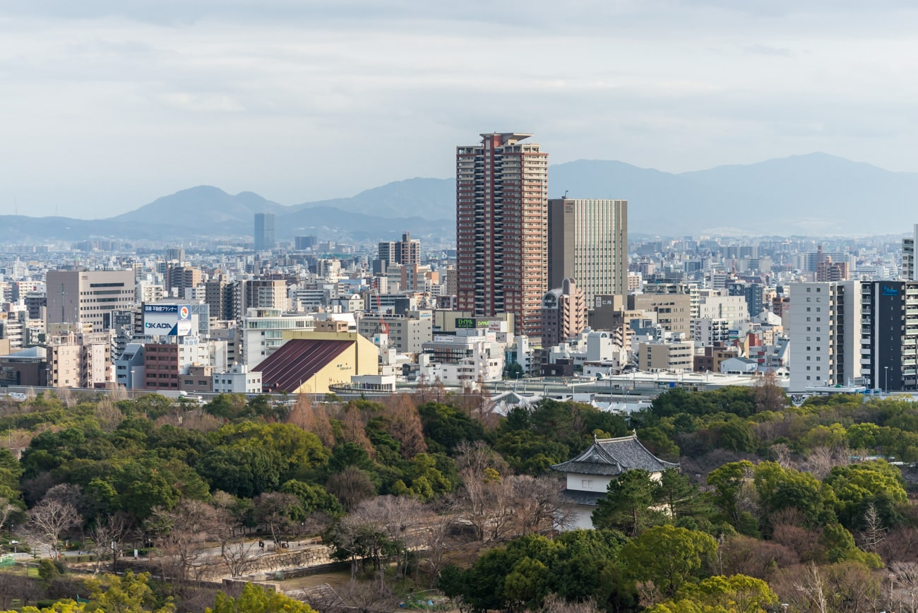 Osaka City and Mountains Landscape. View from Osaka Castle, Japan.