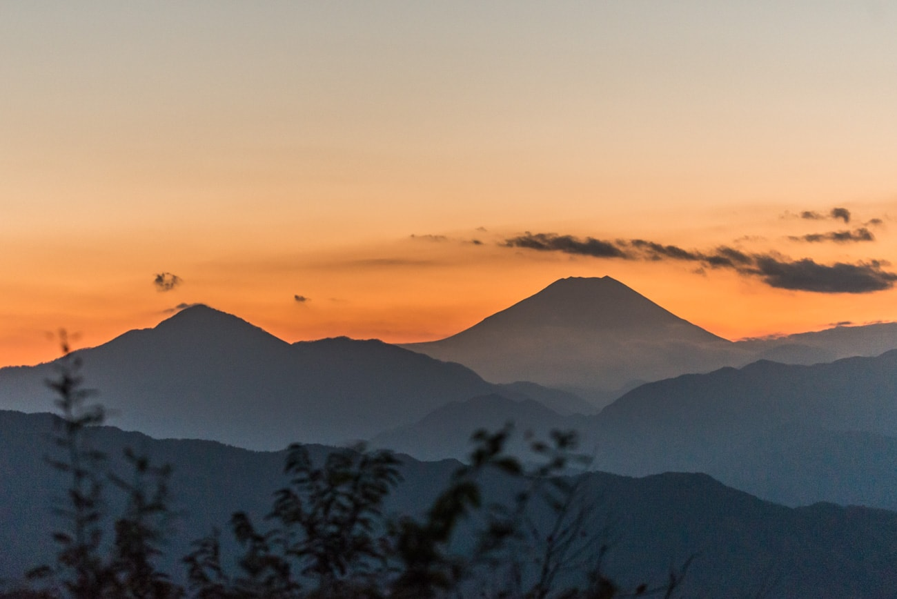 Mt. Fuji Silhouette at Sunset. Scenic landscape from Mt. Takao in Tokyo, Japan.