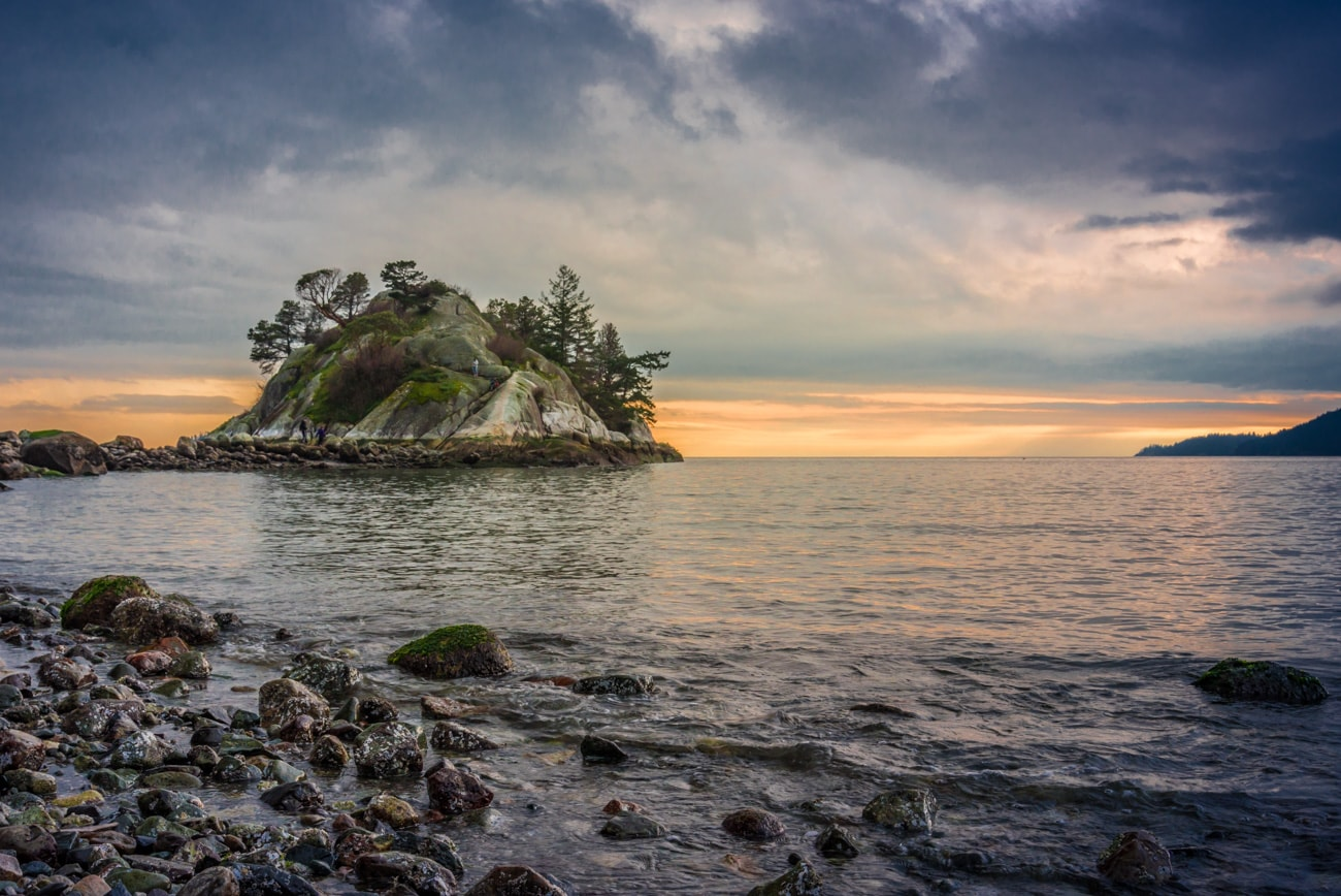 Landscape at Sunset from Whytecliff Park beach on a cloudy day. Whyte Islet on the picture.
