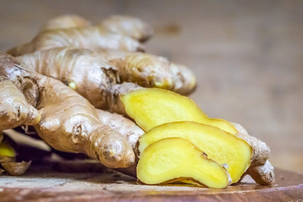 Sliced ginger on a wooden board closeup. Free picture for your blog.